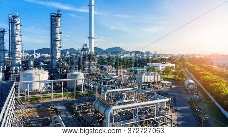 Aerial View Of Chemical Oil Refinery Plant, Power Plant On Blue Sky Background.