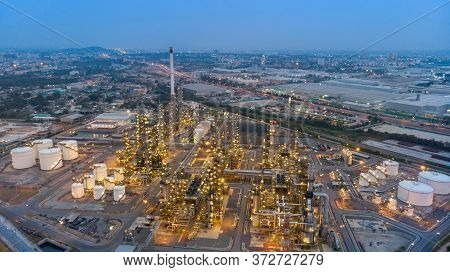 Aerial View Of Chemical Oil Refinery Plant, Power Plant At Sunset Sky For Industry Concept.