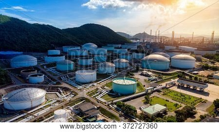 Aerial View Of A Lot Of Oil Depot Gas Storage Tank Infront Of Oil Refinery Tower In The Morning For