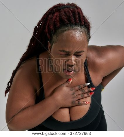 Pain. Close Up Shot Of Plump, Plus Size African American Woman In Sportswear Getting Tired, Exhauste