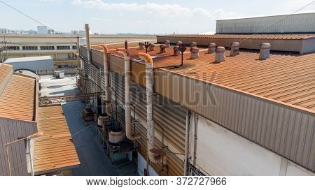 Aerial View Of Roof With Ball Spinning Ventilation At Old Factory.