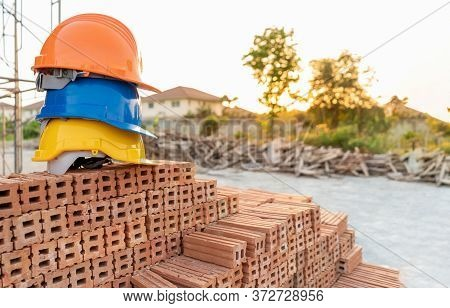 Safety Team Helmet Engineering Construction Worker Equipment At Construction Site On A Pile Of Brick
