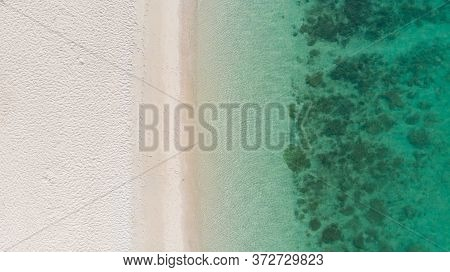Aerial View Of Sand Beach On Sunny Day With The Beautiful Sea Water On Holiday Time Concept Summer O