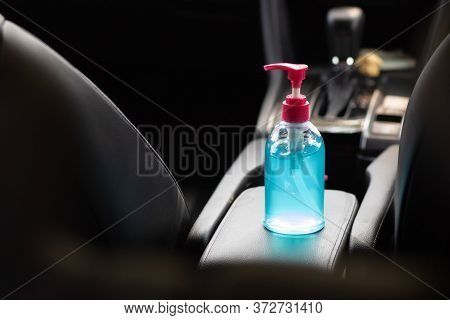Blue Alcohol Gel Bottle Placed In The Car. For Washing Hands Anti-virus And Anti-bacteria And Anti-v