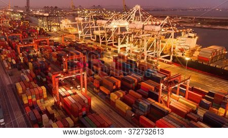 Aerial Of Cargo Crane And Container Big Tank In The International Terminal Yard Port, Cargo Ship Und