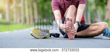Young Adult Male With His Muscle Pain During Running. Runner Man Having Leg Ache Due To Plantar Fasc