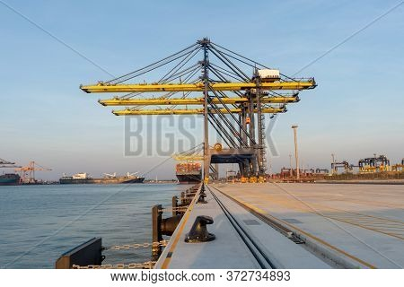 Cargo Crane In The International Yard Port For Loading Big Tank From Ship To Truck Concept Logistic