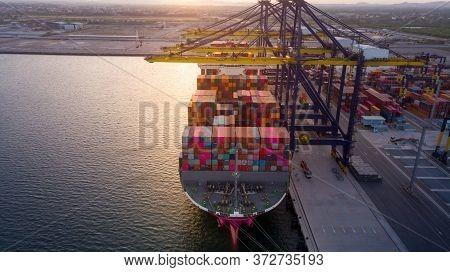 Crane Loanding Cargo Container To Container Ship In The International Terminal Yard Port  Concept Fr