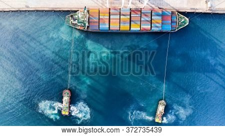 Cargo Container Ship Was Dragged By Tug Boat In The International Terminal Cargo Yard Port Import Ex