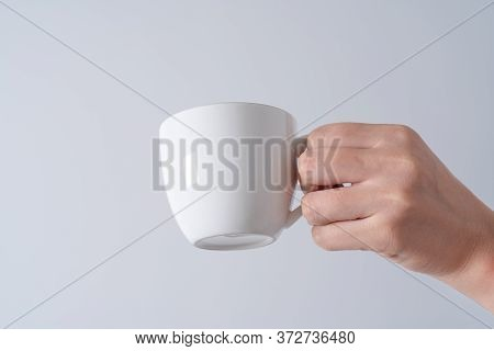 Hand Holding A Cup Of Coffee On White Background Isolate, Asia Woman Hand.