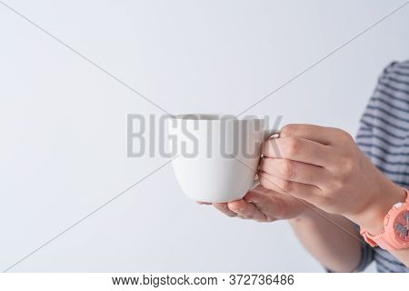 Hand Holding A Cup Of Coffee On White Background Isolate, Asia Woman Hand With White Coffee.