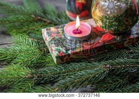 Candle Holder Decorated With Decoupage Technique With Christmas Motifs And Fir Branches On A Wooden