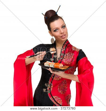 Woman In Traditional Dress With Sushi
