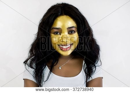 Closeup Beauty Portrait Of Charming African Young Girl With Healthy Soft Skin, With Antiaging Golden