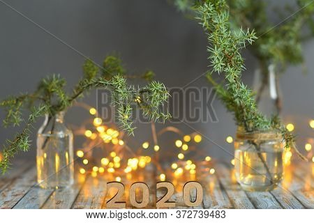 Christmas And New Year Decorate On Wood Background,wooden Numbers 2020 With Bokeh New Year's Lights.