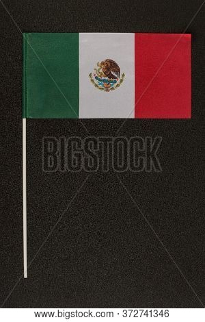 Table Flag Of Mexico On Black Background. Striped Tricolor Green White Red. Vertical Frame.