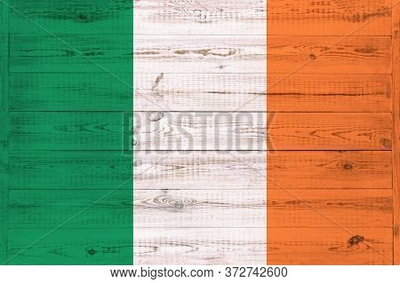 Ireland Flag Painted On An Old Wooden Background. Textured Scratched Backdrop And Concept Of Flag Da