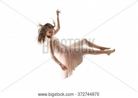 Mid-air Beauty Cought In Moment. Full Length Shot Of Attractive Young Woman Hovering In Air And Keep