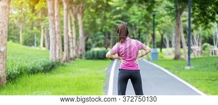 Young Adult Female With His Muscle Pain During Running. Runner Woman Having Back Body Ache Due To Pi