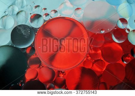 Colorful Abstract Background With Gradient Of Teal And Red Colors, Oil Drops In Water Abstract Bubbl
