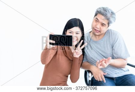 Blurred Soft Images Of Asian Wife And Husban Who Is Paitiant From Nervous System And Paralysis Or He