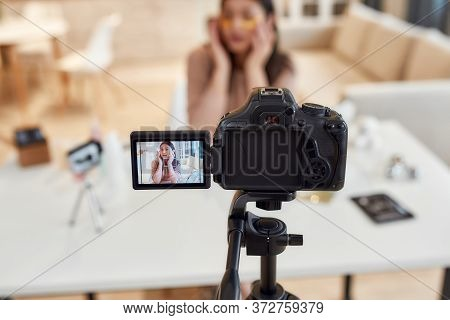 Young Female Blogger Recording A Tutorial Video For Her Beauty Blog About Skincare. Vlogger Testing