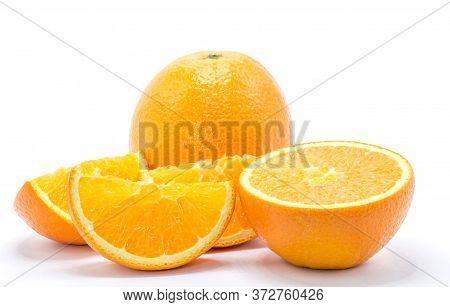 One Orange Fruit And Half Cut Orange On White Background