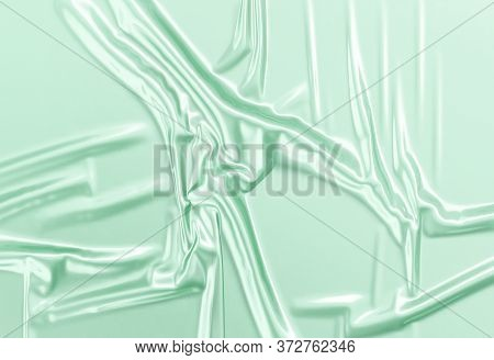 Blank Green Crumpled Plastic Foil Wrap Overlay Mock Up, 3d Rendering. Empty Disposable Cellophane Pa