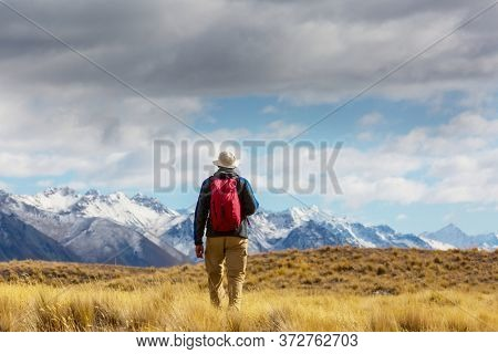 Hiking man in the mountains  outdoor active lifestyle travel adventure vacations summertime. Hike concept