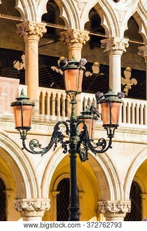 Palazzo Ducale in Piazza San Marco. Decorative street lamps and facade decorative elements. Doge's Palace. Magical journey to Venice. The concept of educational, cultural and photo tourism