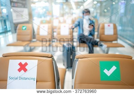Social Distancing Or Physical Distancing Concept. Correct And Cross Symbol On Seat At Waiting Area O