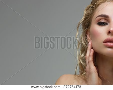 Half A Beauty Portrait With Beautiful Fashionable Evening Make-up, Pink Liner On Eyes And Extremely