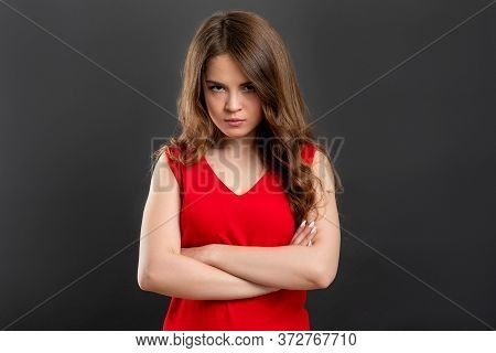 Offended Woman Portrait. Irritation Disappointment. Unhappy Lady In Red With Crossed Arms Isolated O