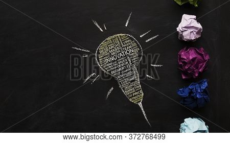 Innovation And Brainstorming Concept. Light Bulb Drawn On Chalkboard With Business Inspirational Wor