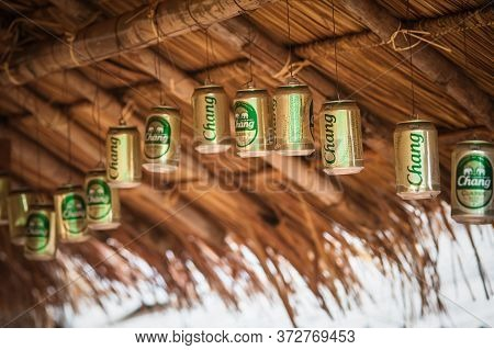 Empty Thailand Chang Beer Classic Cans Hanging As A Decoration
