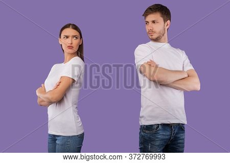 Relationship Problems. Offended Couple Standing Back To Back Ignoring Each Other After Quarrel, Purp