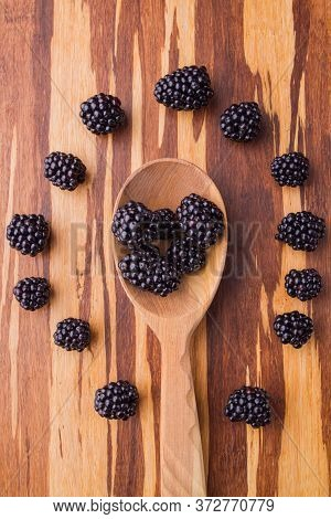 Wooden Tablespoon With Blackberries. Berries Arranged Around, Top View, Flat Lay.