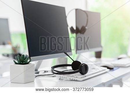 Call Center And Customer Service Concept. Computer Monitor With Blank Space For Your Design And Voip