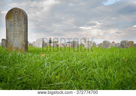 Lancaster Usa - October 22 2014; Amish Cemetery And Headstones Under Cloudy Sky In Lancaster County,