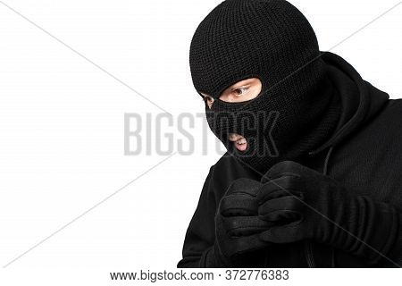 Closeup Portrait Of Greedy Disguised Villain In Black Mask Looking At Something To Steal, Copyspace,