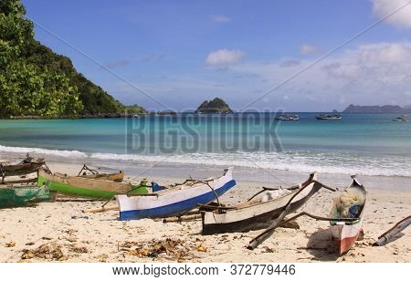 Small Fishing Boats At Mawun Beach, Lombok. Kuta Lombok Is An Exotic Paradise On The Indonesian Isla
