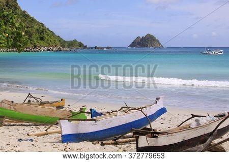 Jukung Fishing Boats At Mawun Beach, Lombok. Kuta Lombok Is An Exotic Paradise On The Indonesian Isl