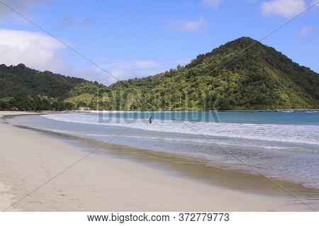 Sunny Day On White Sand Mawun Beach Lombok. Kuta Lombok Is An Exotic Paradise On The Indonesian Isla