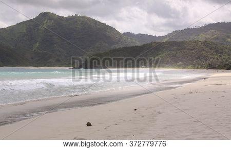 Coconut On Mawun Beach Lombok, Indonesia. Kuta Lombok Is An Exotic Paradise On The Indonesian Island