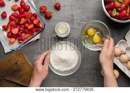 Strawberry pie ingredients on the table, top view. Baking ingredients, strawberry cake. Strawberry recipe