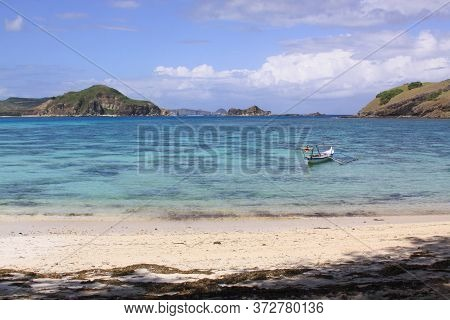 Traditional Indonesian Fishing Boat At Kuta Lombok. Kuta Lombok Is An Exotic Paradise On The Indones