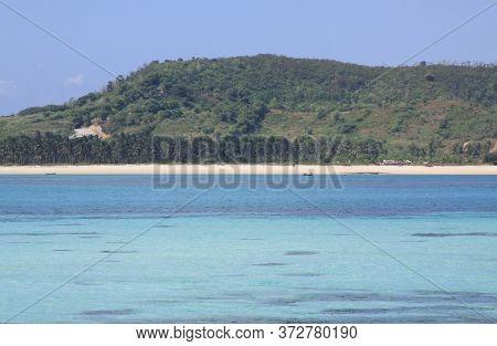 Blue Sea Water At Kuta Beach Lombok, Indonesia. Kuta Lombok Is An Exotic Paradise On The Indonesian
