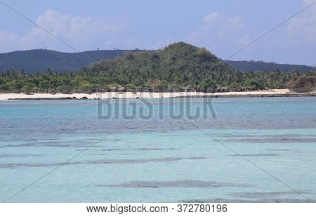 Blue Ocean Water At Kuta Beach Lombok, Indonesia. Kuta Lombok Is An Exotic Paradise On The Indonesia