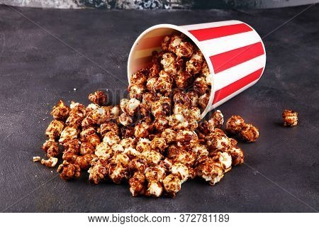Tasty Popcorn With Caramel In Cups On Table