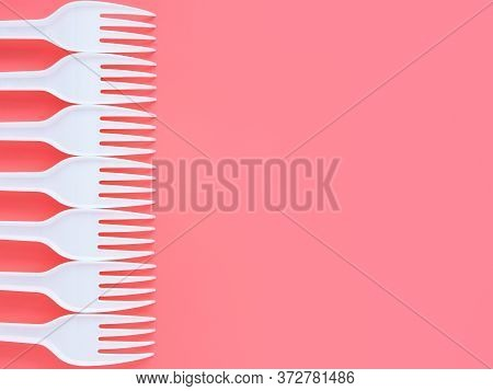 White Plastic Forks On A Pink Background, Top View, Flat Lay. Background Of Disposable Tableware Wit